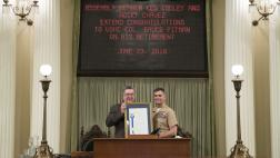Assemblymember Cooley presenting Assembly Resolution to Colonel Bruce Pitman on his retirement from the USMC.